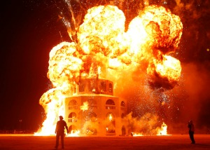 "The Man is engulfed in flames during the Burning Man 2012 ""Fertility 2.0"" arts and music festival in the Black Rock Desert of Nevada"