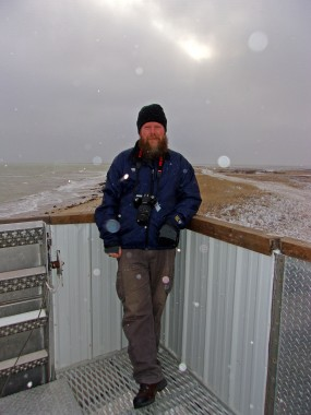 Rev Kane relaxing in the arctic snow flurries