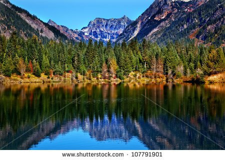 stock-photo-gold-lake-reflection-mount-chikamin-peak-fall-snoqualme-pass-wenatchee-national-forest-wilderness-107791901